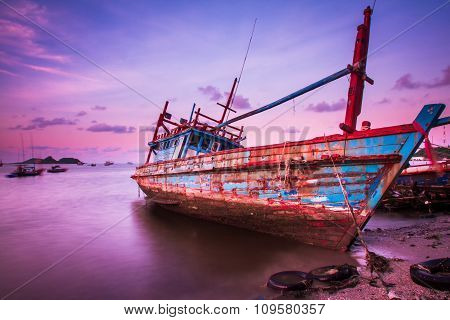 Large Fishing Boats Beached At Low Tide.