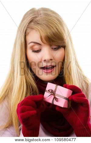 Smiling Woman In Woolen Gloves Opening Gift For Christmas Or Other Celebration