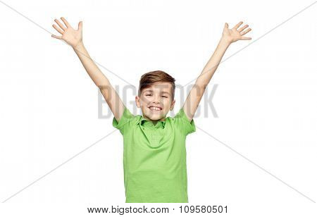 childhood, fashion, power, joy and people concept - happy smiling boy in green polo t-shirt raising hands up