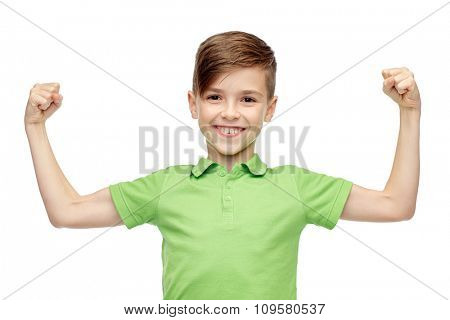 childhood, power, strength and people concept - happy smiling boy in green polo t-shirt showing strong fists