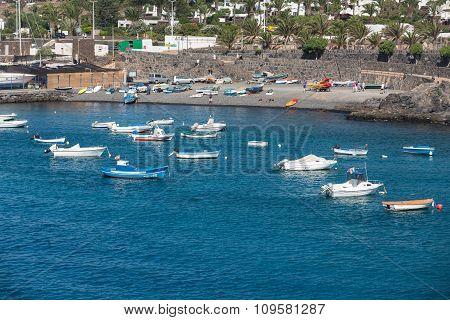 LANZAROTE, SPAIN - SEPTEMBER 9, 2015: Fishing boats in Playa Blanca Canary Island Lanzarote.Spain