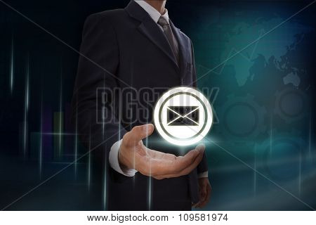 Businessman showing e-mail icon symbol on screen. business concept