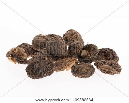Dried Shiitake Mushrooms On White Background