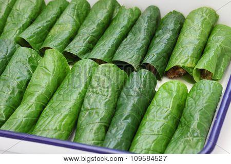 preparing bo la lot, vietnamese cuisine