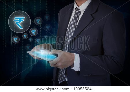Businessman hand touch screen rupee sign icons on a tablet.