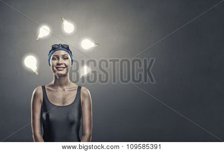 Portrait of woman swimmer in cap and glasses
