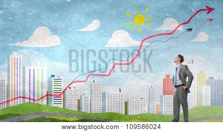 Confident businessman with arms on waist and red growing arrow graph