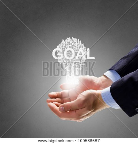 Businessman holding in hands successful idea concept