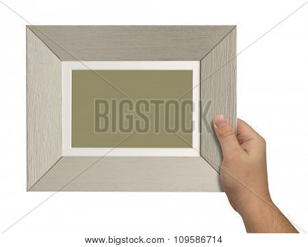 man's hand holding a wooden box isolated on white background. close up