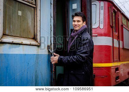 Smiling Man Getting On Train