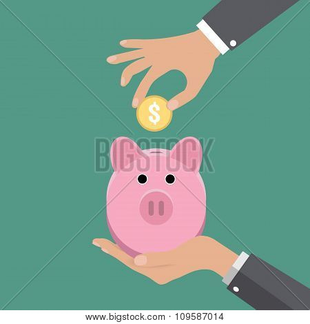 Piggy bank and hand put coin
