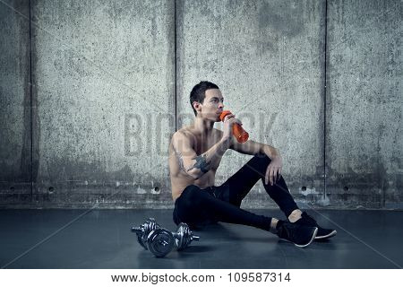 Active man working out water bottle and dumbell