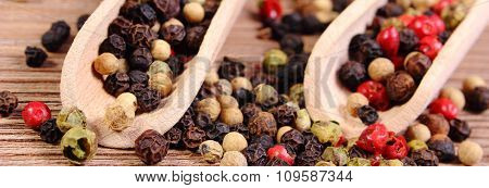 Fresh Colored Pepper With Spoon On Wooden Background