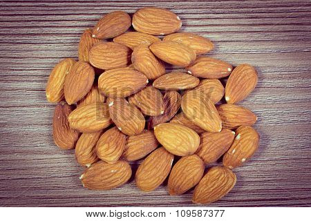 Vintage Photo, Heap Of Almonds On Wooden Background