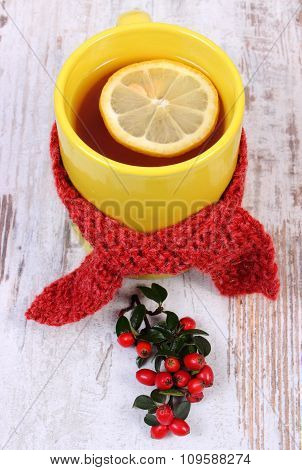 Cup Of Hot Tea With Lemon Wrapped Woolen Scarf And Cotoneaster, Warming Beverage For Flu