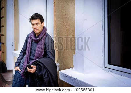 Handsome Businessman Standing With Phone