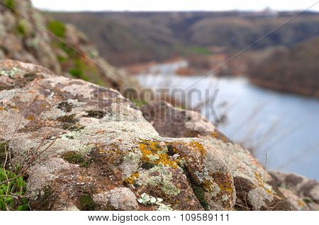 granite rocks on the background of the river