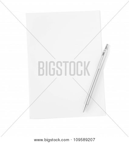 White Sheet Of Paper With Metal Ballpoint Pen