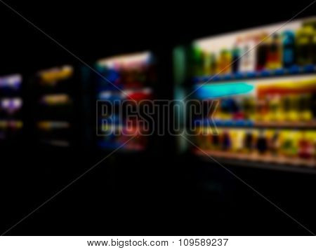 Blurred / Defocussed Abstract Background Of Colorful Soft Drinks / Juice Bottles Vending Machines