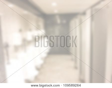 Blurred / Defocussed Abstract Background Of Men Restroom In An Office Building With Vintage Color Ef