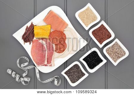 High protein health food diet of meat, fish, pulses, grains and seeds and tape measure. Also eaten by body builders.