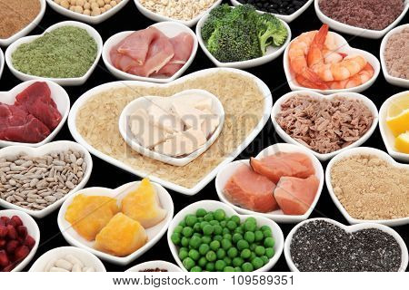 Health and super food with fish and meat, supplement powders, pulses, grains, nuts, seeds, cereals, fruit and vegetable selection. Also diet of body builders.