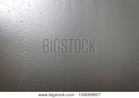 Water drop on ground glass in toilet