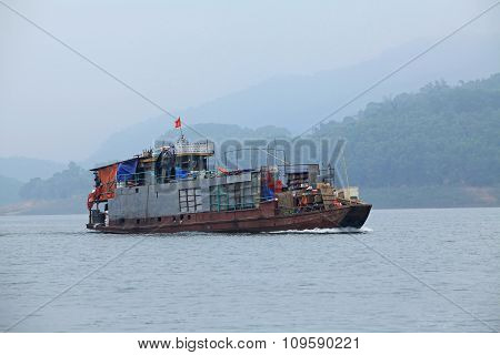 A cargo ship running on Song Da hydro-power lake