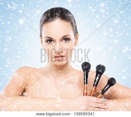 Beauty portrait of young, attractive, fresh, healthy and natural woman over winter background