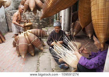 Vietnamese craftsmen making bamboo handicraft products