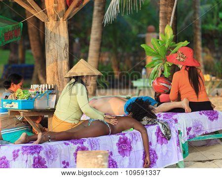 traditional asian beach massage