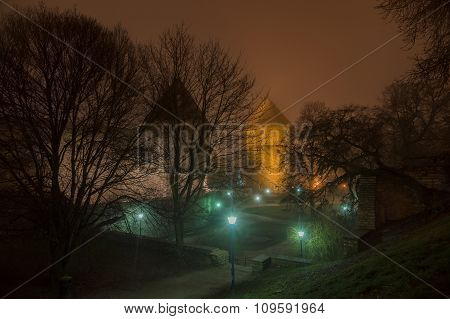 Towers And Lanterns Of Tallinn Old Town In Night Fog