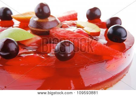 sweet cold red jelly cake with cherry