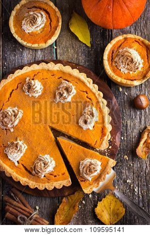 Pumpkin Tarts With Whipped Cream And Cinnamon