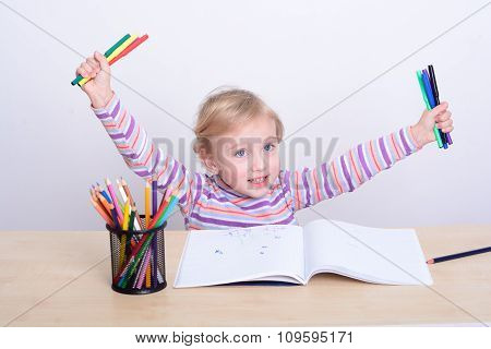 Girl Drawing With Colorful Pencils