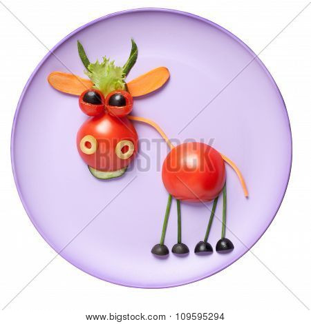 Bull Made Of Vegetables On Pink Plate