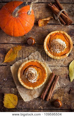 Pumpkin Tartlets With Whipped Cream And Cinnamon