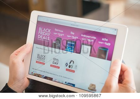Zhongshan,china-november 27, 2015:young Women Shopping Through Tablet On Amazon On Black Friday.more