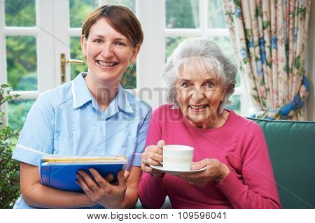 Senior Woman With Carer At Home