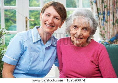 Senior Woman At Home With Carer