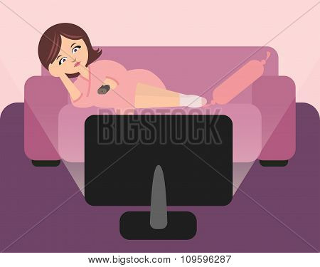 Cute housewife lying on sofa and watching tv.