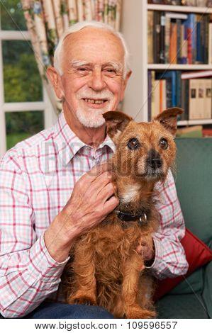 Senior Man At Home With Pet Dog