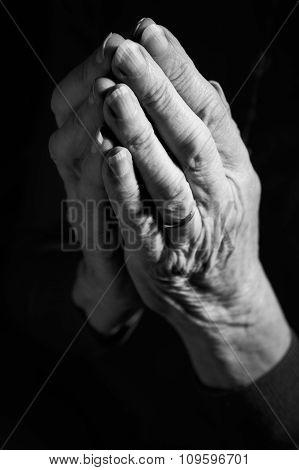Black & White Image Of Senior Woman's Hands Joined In Prayer