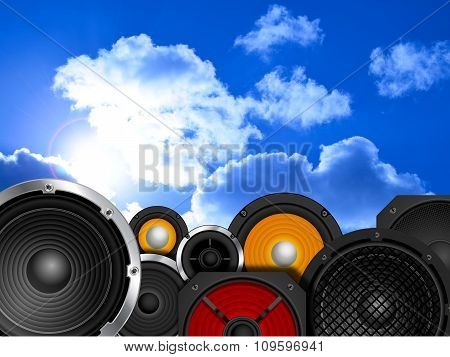 Different types of speaker against sky background