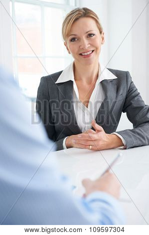 Businessman Interviewing Female Job Candidate
