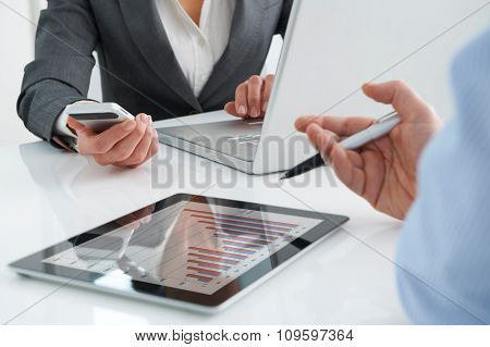 Business Meeting Using Digital Tablet, Laptop And Mobile Phone