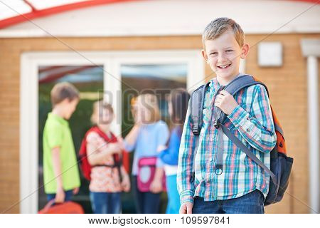 Boy Standing Outside School Classroom With Rucksack