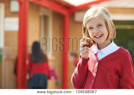 Female Pupil Eating Apple At Breaktime