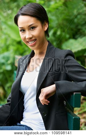 Portrait Of Attractive Young Woman In Park