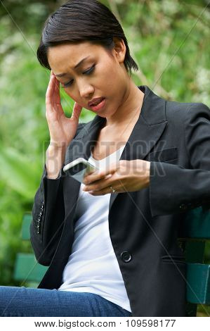 Worried Young Woman Reading Text Message
